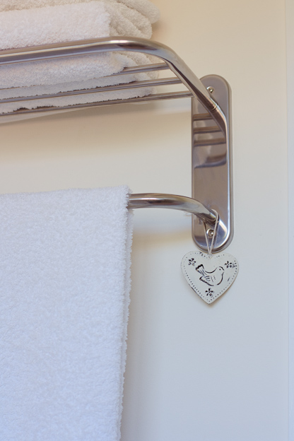 Towel rail and white towels