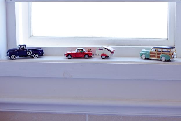 Model cars on a window sill