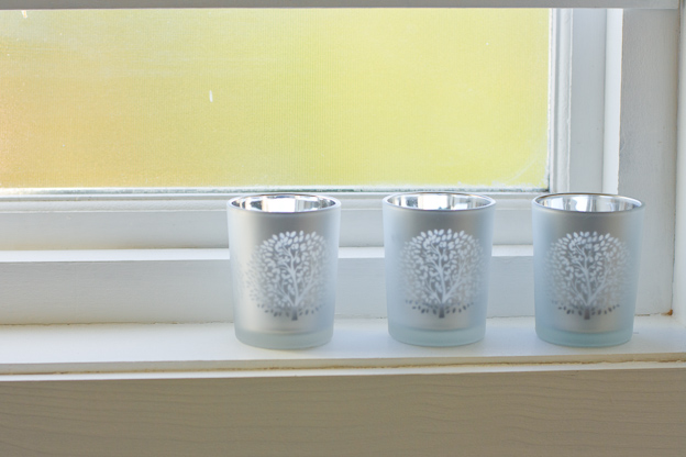 Silver candle holder with tree etching