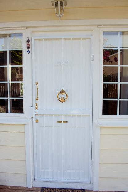 White front door, claddagh knocker, nazar and cead mile failte placque