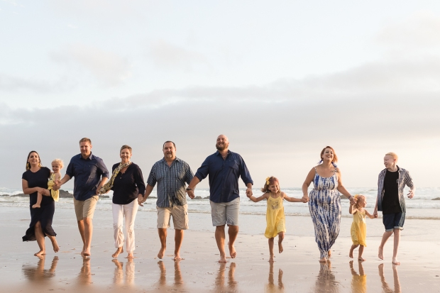 Large family group running at sunset on a sedgefield beach photoshoot