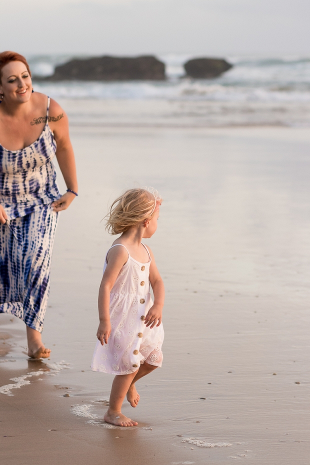 Mom chasing daughter at sunset during a Sedgefield beach photoshoot
