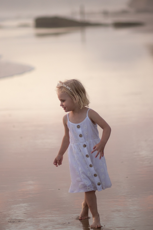 Little girl running on a Sedgefield beach photoshoot