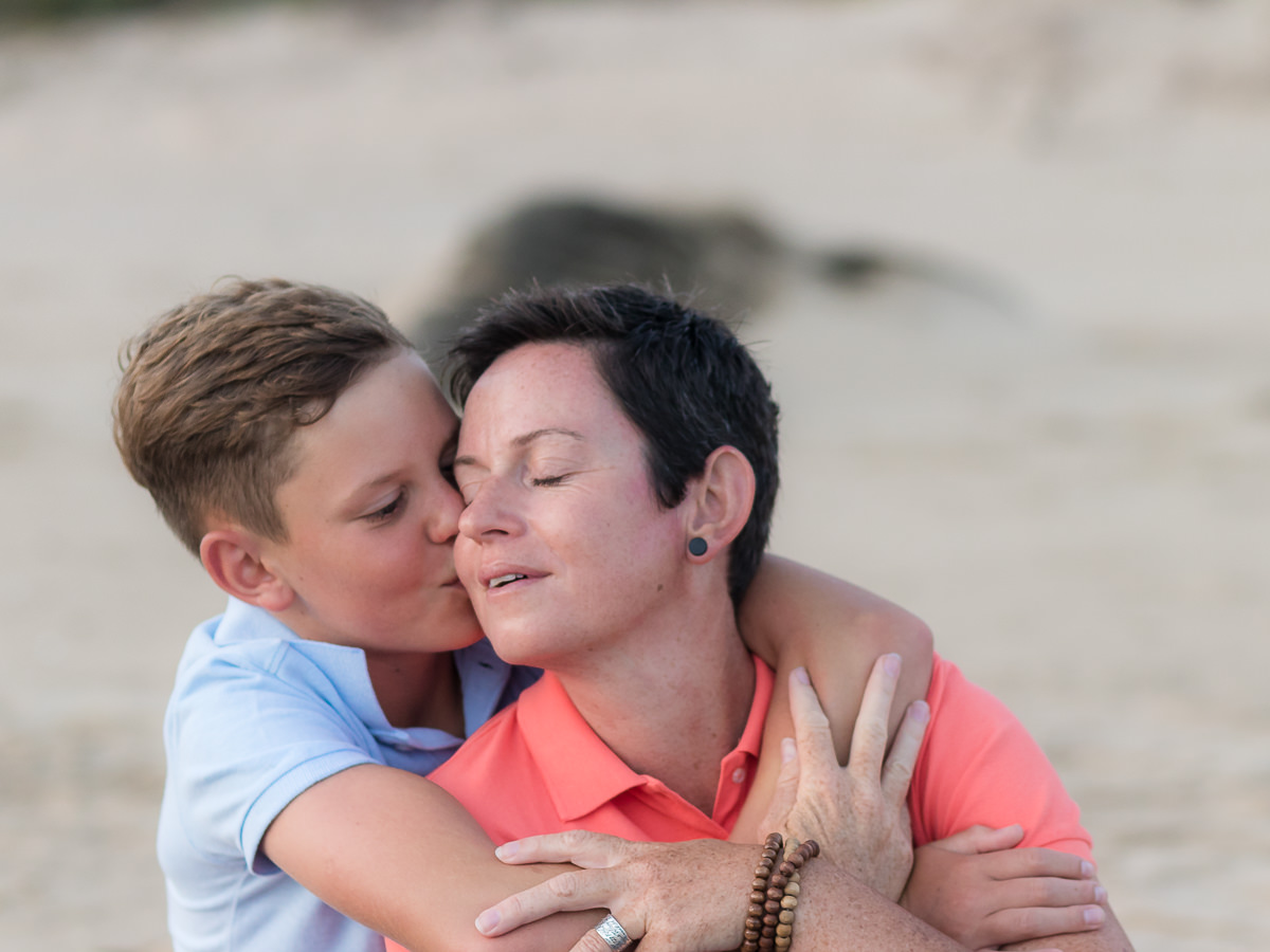 Mother and son on a beach at sunset in Sedgefield garden route during a photoshoot by moi du toi photography