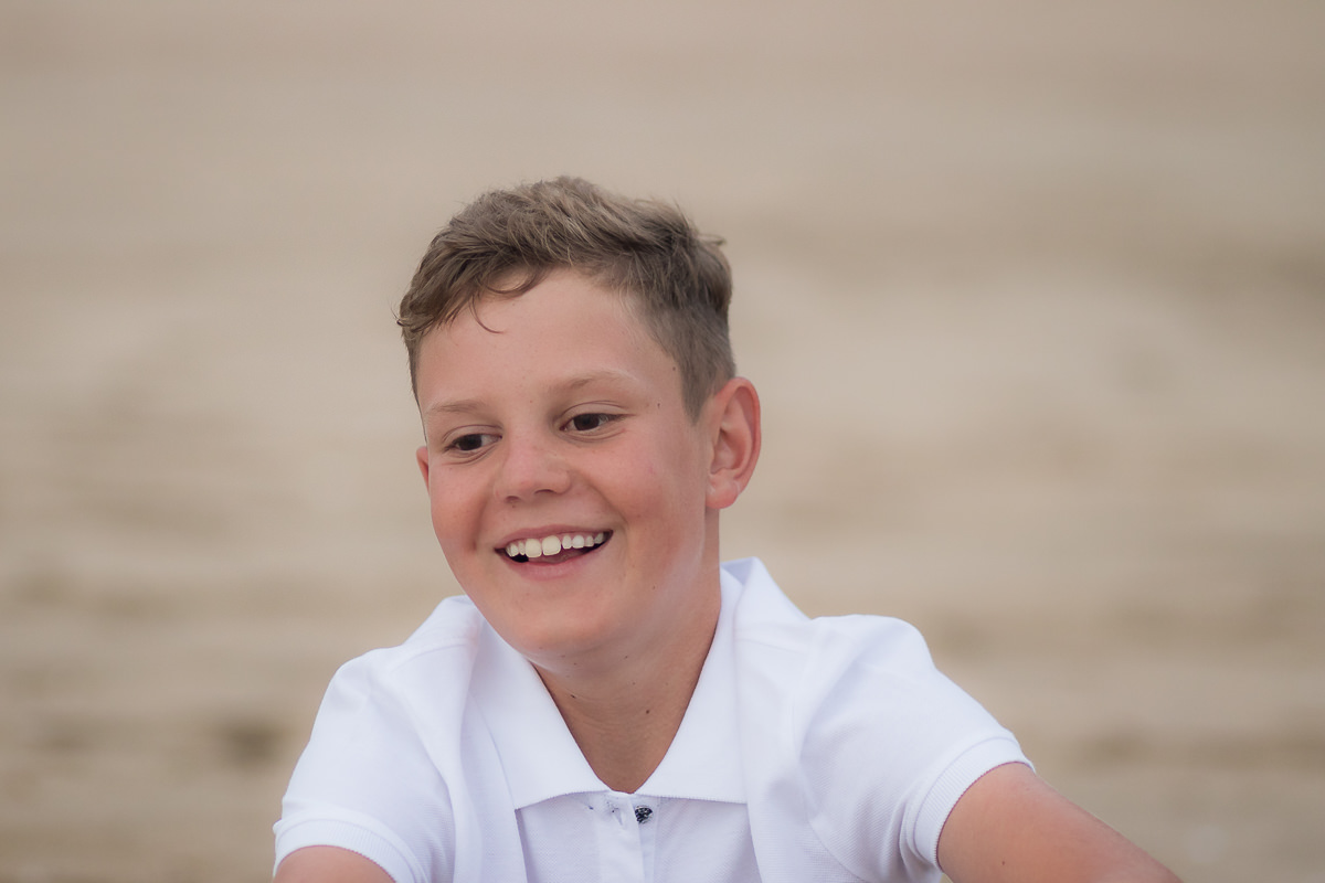 young boy on the beach at sunset in Sedgefield garden route during a photoshoot by moi du toi photography