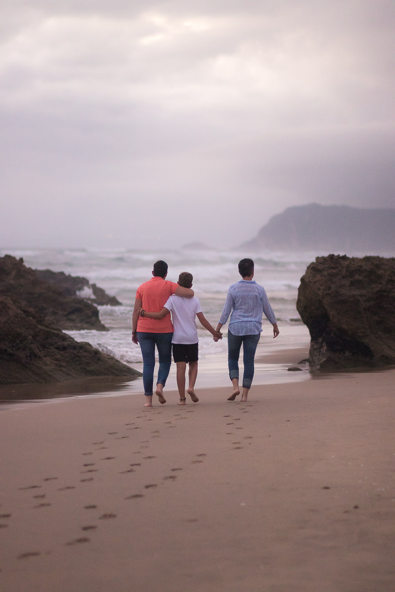 two mother and their son playing on a beach at sunset in Sedgefield garden route during a photoshoot by moi du toi photography