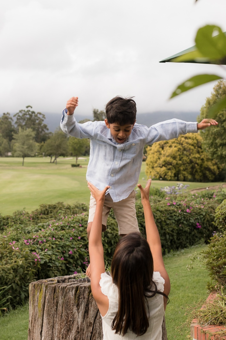 Little boy jumping into Mothers arms during family session at Fancourt George
