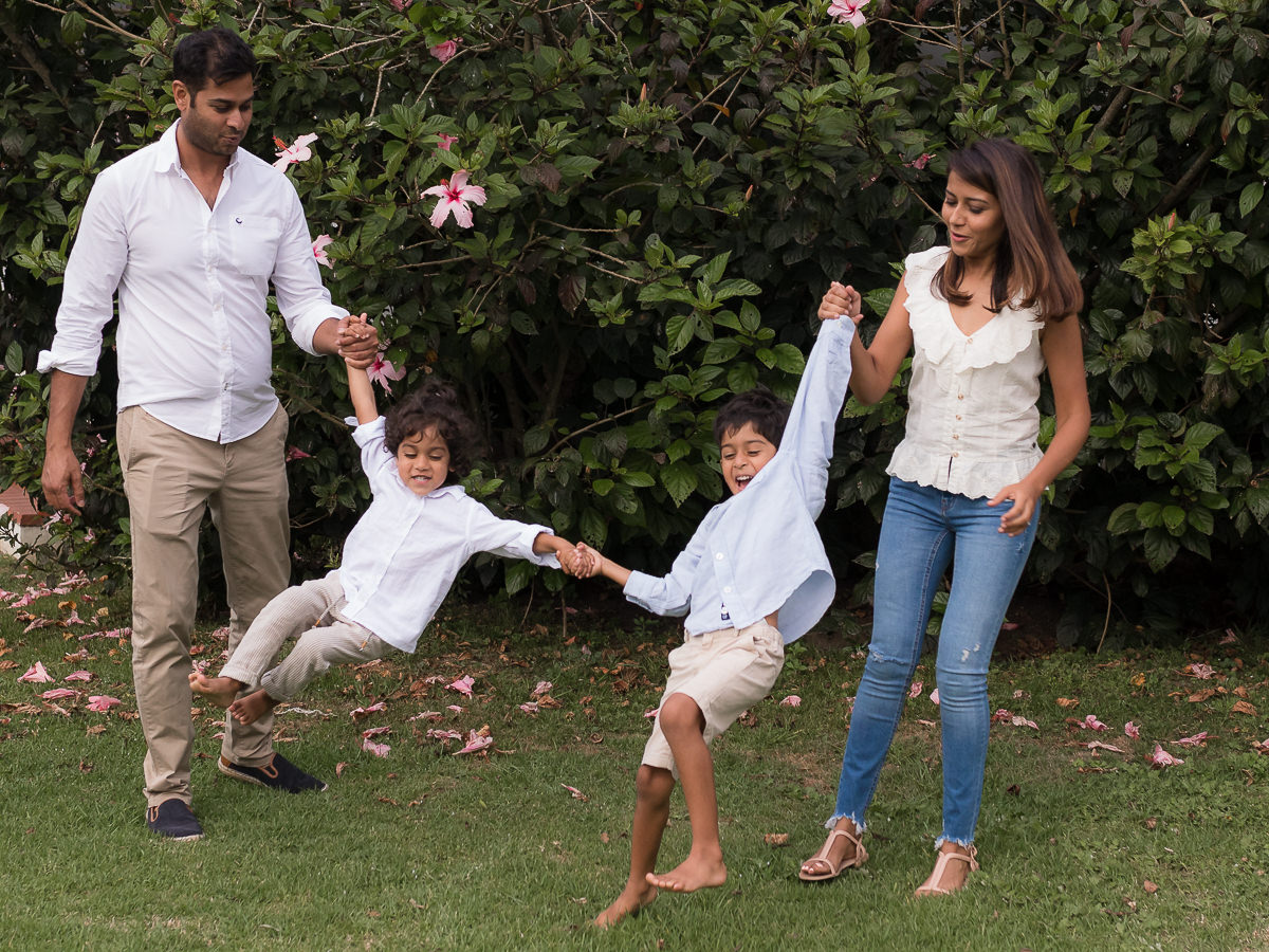 Family playing together during photo shoot at Fancourt George