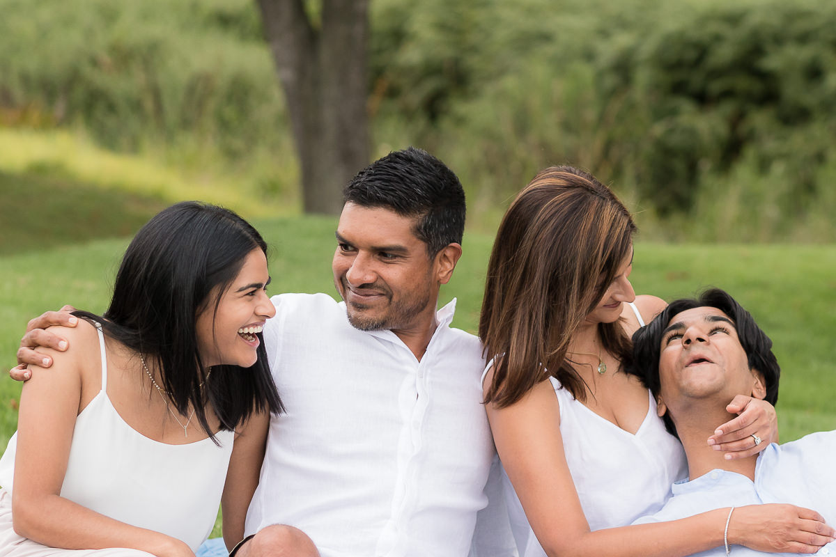 family of four posing for photoshoot at Fancourt in George