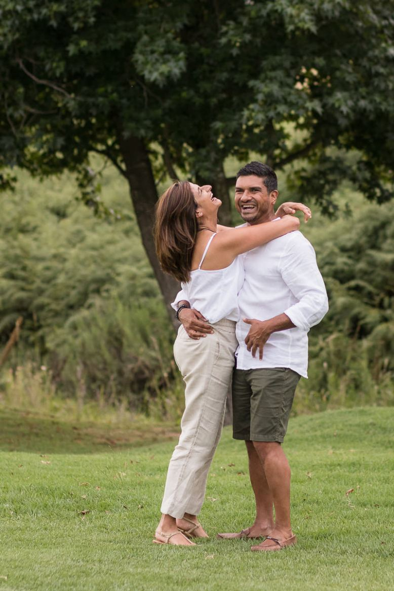 Couple hugging and laughing during Family photo session at Fancourt George