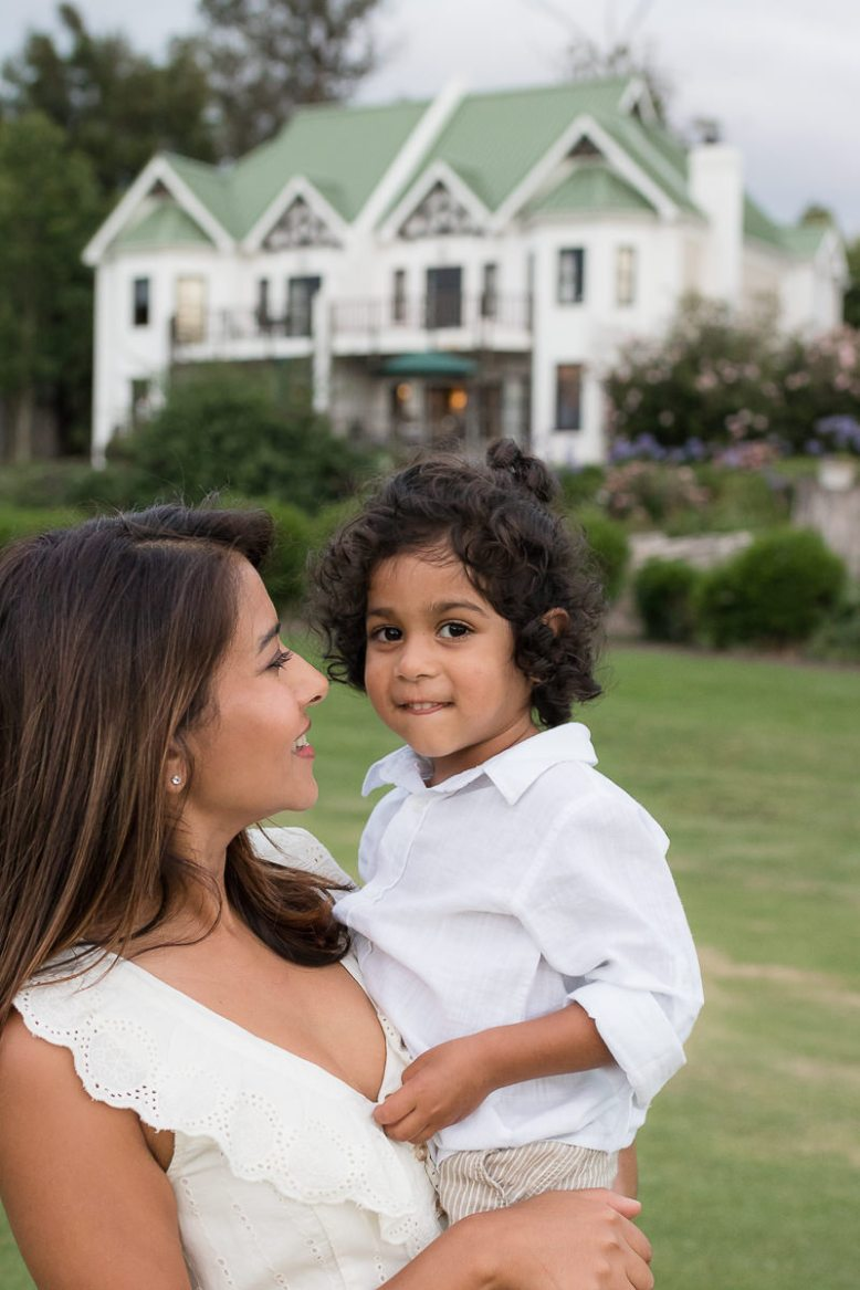 Mother holding little boy during family photoshoot at Fancourt George