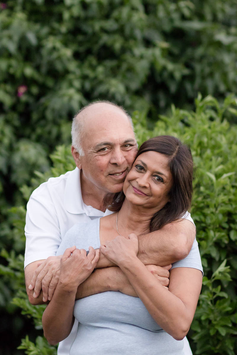 Older Couple hugging during family photo session at Fancourt George