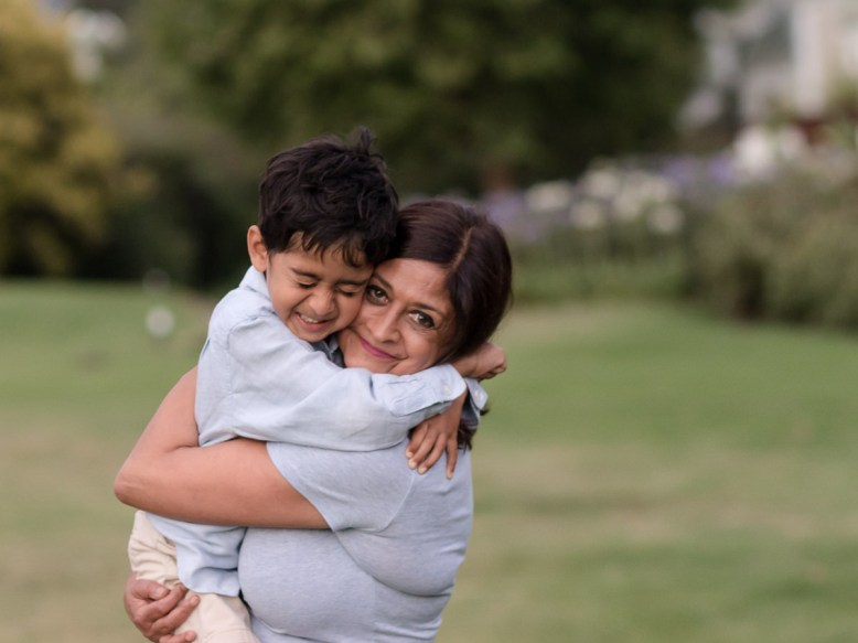 LIttle boy hugging his Granny very tightly during a family photo session at Fancourt George