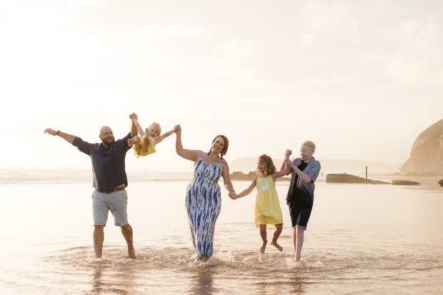 Family running on beach sedgefield beach photoshoot