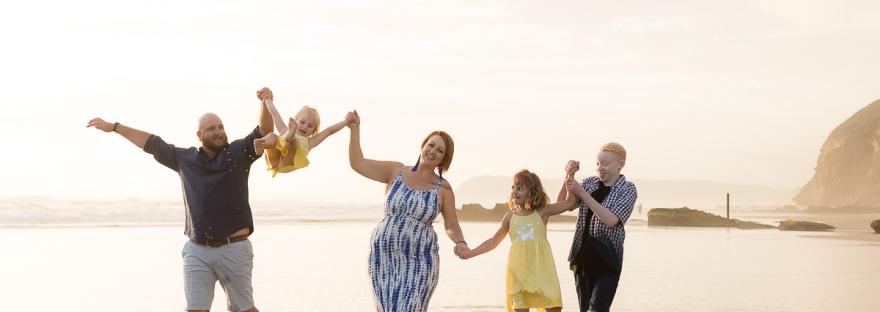 Family running on beach sedgefield beach photoshoot