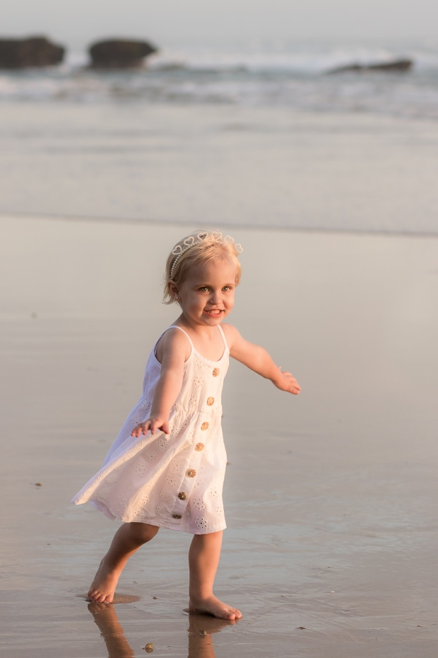 Little girl running on beach sedgefield beach photoshoot