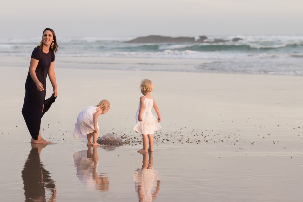 Woman and two little girls playing on beach sedgefield beach photoshoot