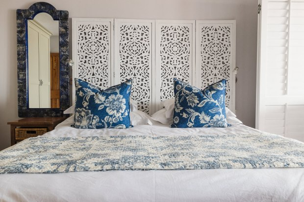 Stylish double bed in blue and white colours at Cola Beach guest house sedgefield