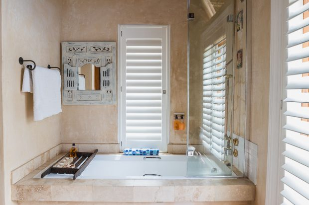 Luxury ensuite bathroom and shower in warm colours at Cola Beach guest house sedgefield