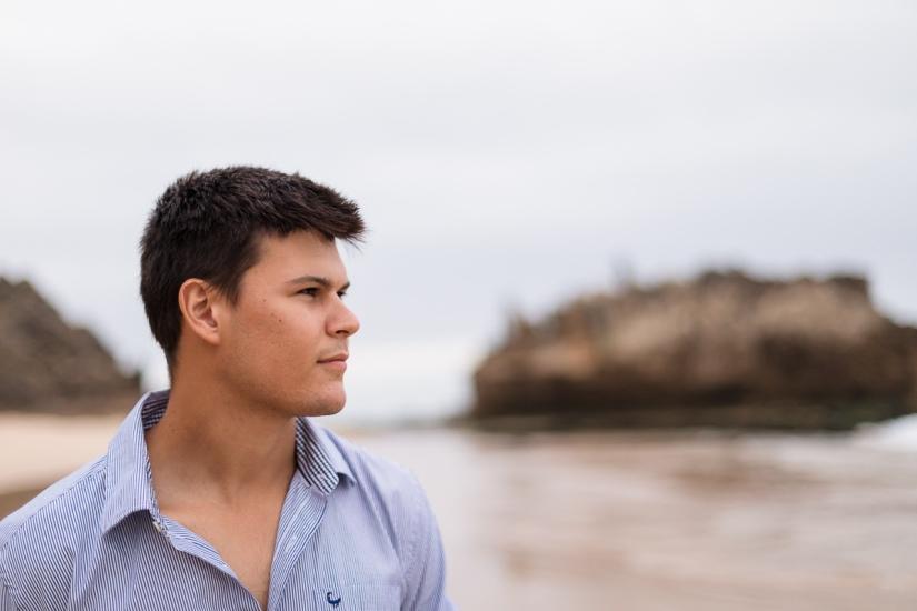 dark haired young man family beach photo shoot brenton on sea knysna