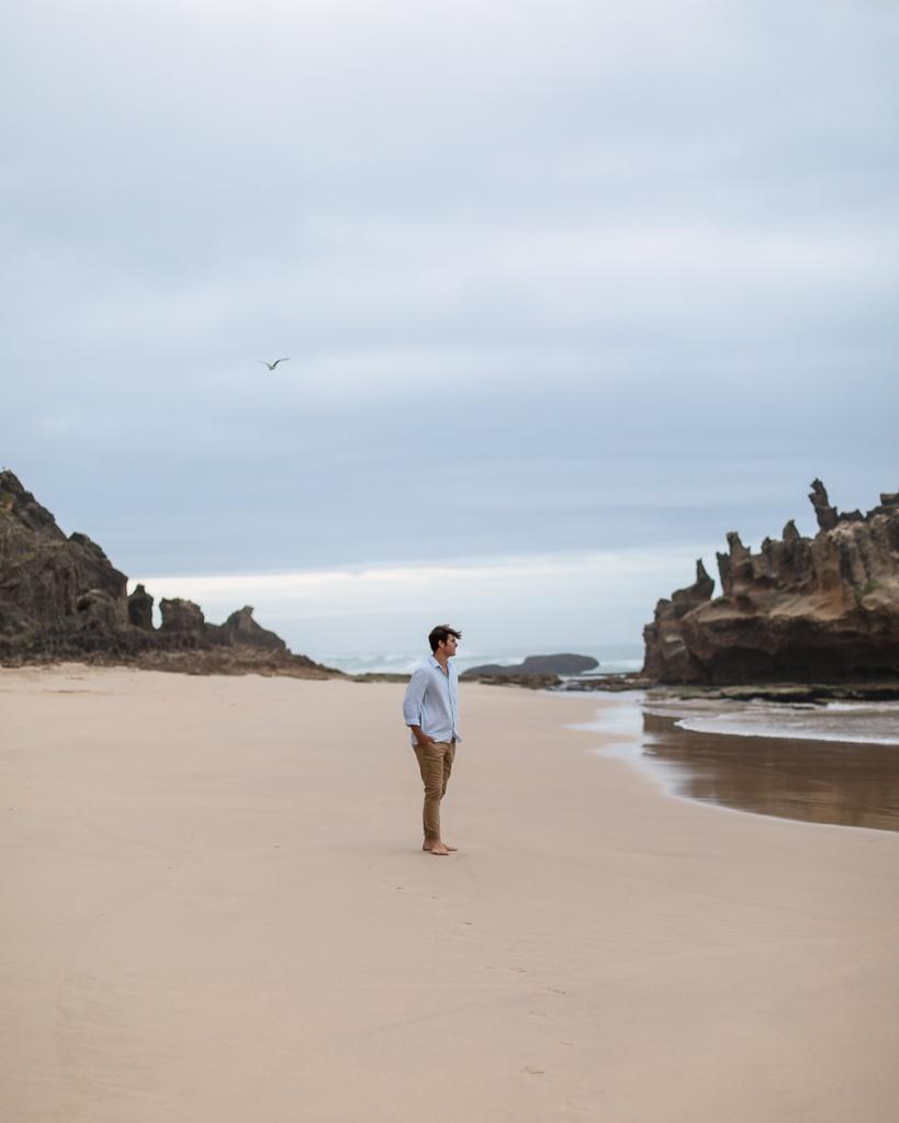young man walking family beach photo shoot brenton on sea knysna