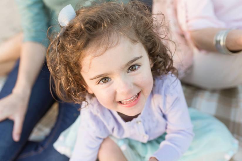 little girl smiling family photo session at Myoli Beach Sedgefield photo