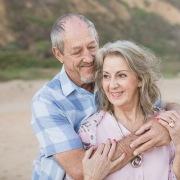 couple kissing sunset family photo session at Myoli Beach Sedgefield photo