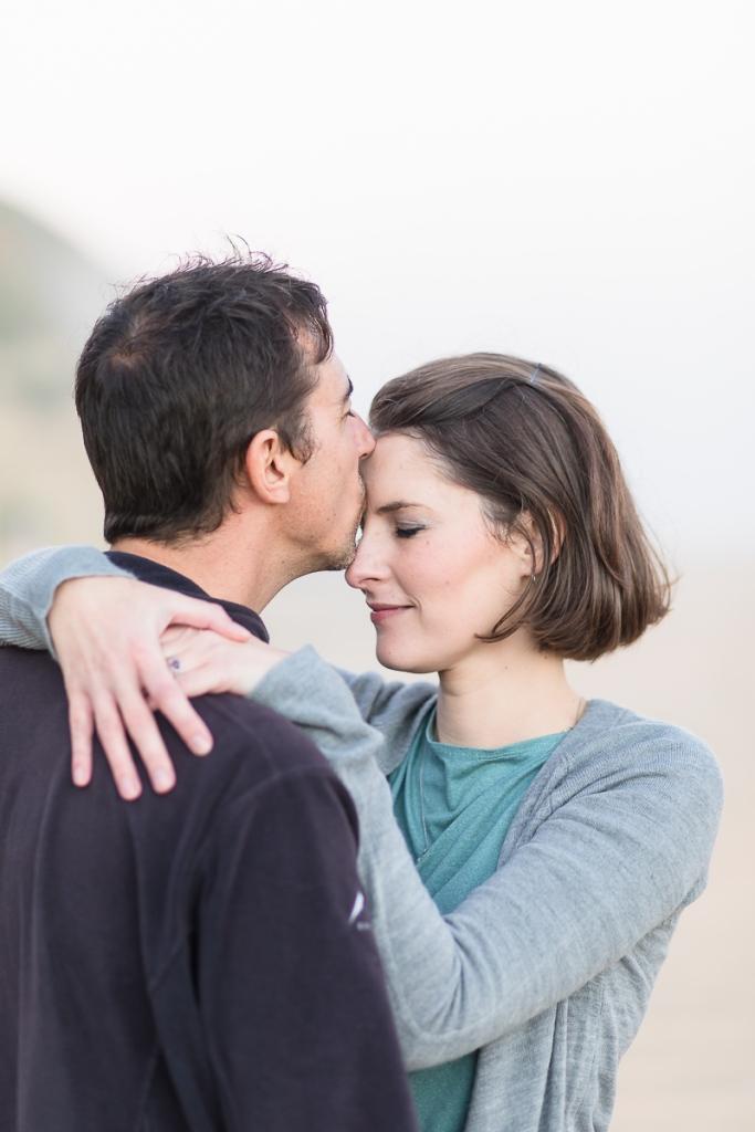 couple kissing sunset family photo session at Myoli Beach Sedgefield photographer moi du toi