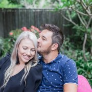 man kissing woman on temple during couples photoshoot sedgefield knysna
