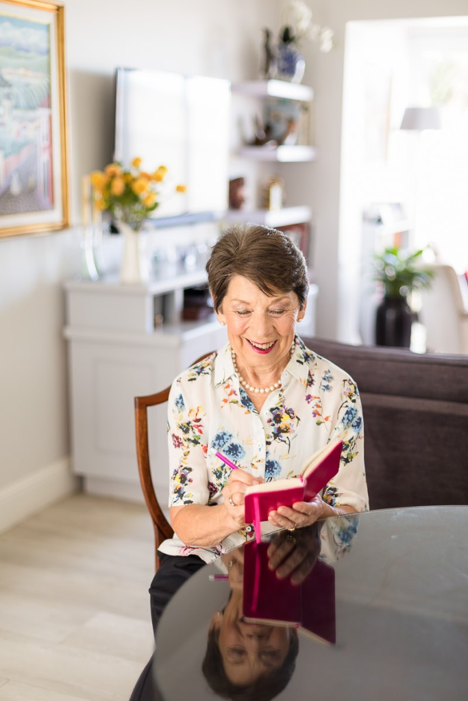 woman smiling reading sitting pose personal branding photo session knysna