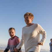 mother and son playing laughing running family beach session at Myoli beach Sedgefield