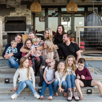 Large family group photo session sitting on steps Cloud 9 Estate Knysna