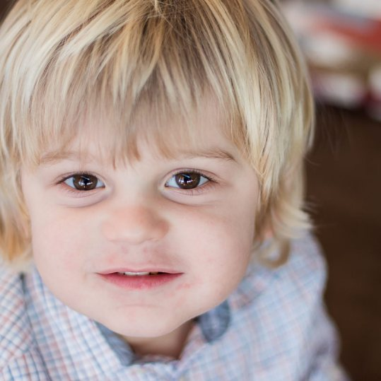 Toddler making eye contact with camera close up portrait family photoshoot Knysna