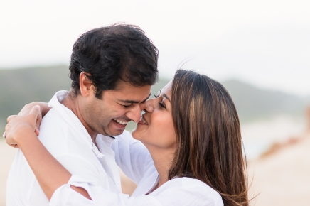 romantic image of couple whispering and laughing