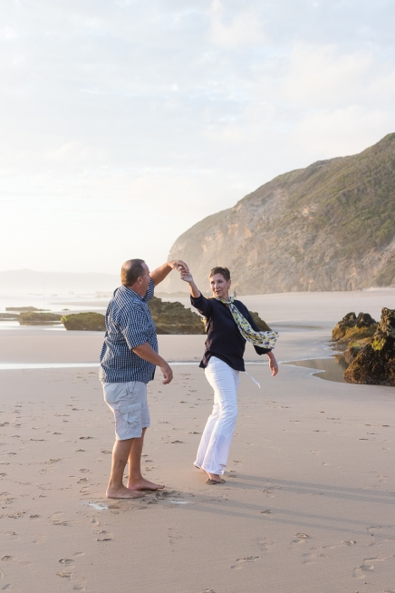romantic image of couple dancing on the beach