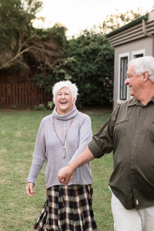 romantic image of couple running and laughing