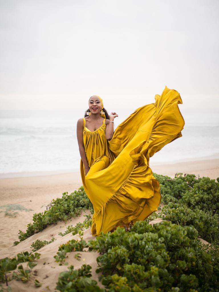 fashion model posing on myoli beach sedgefield during a sunset photoshoot by photographer moira du toit